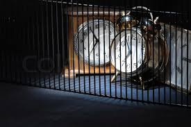 clocks behind bars